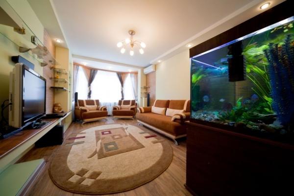 Овальные ковры в интерьере гостиной